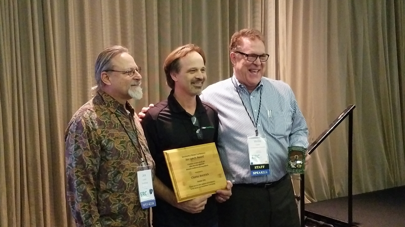 Charles Brennick receives award from Jim Lynch and Willie Cade